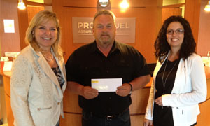Left to right: Chantal Roy, Damage Insurance Agent; Alain Boucher, contest winner; and Isabelle Morin, Director – Personal Insurance Sales and Business Development.